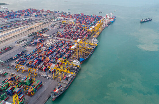 Aerial view panoramic for moving pass sea port warehouse and container ship or crane ship working for delivery containers shipment.