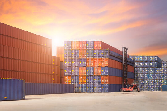 Forklift container loading and unloading cargo into the import-export zone in yard
