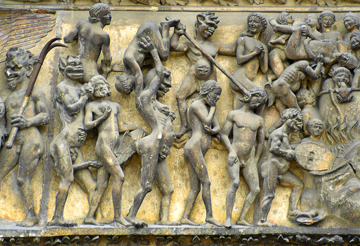 Hell - the sculptural decoration of the main portal of cathedral Saint-Etienne, Bourges, France. Cathedral is UNESCO World Heritage Site.