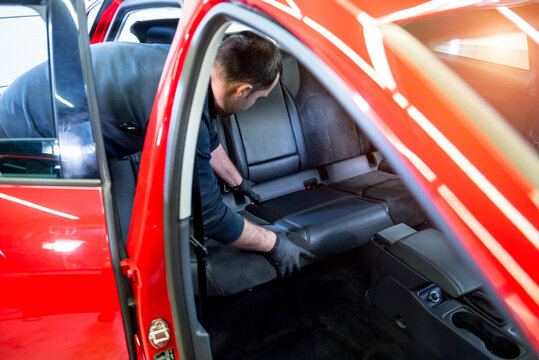 Car service worker disassemble the interior of the car