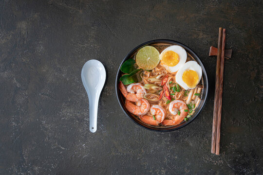 instant noodles ramen in spicy soup with shrimps (Tom Yum Kung) - Asian food style. Pasta, Noodles, junk food concept