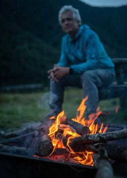 Men sitting near camping fire