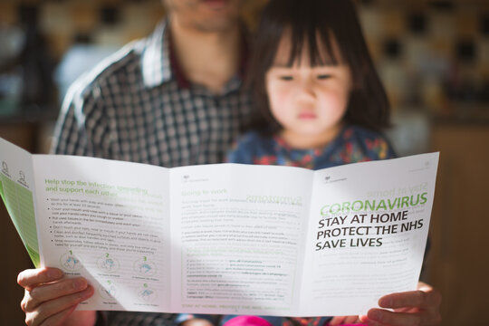 Man With Daughter Were Reading Covid-19 Lockdown Letters From The Government