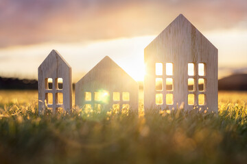 Wall Murals London Ecological wood model house in empty field at sunset