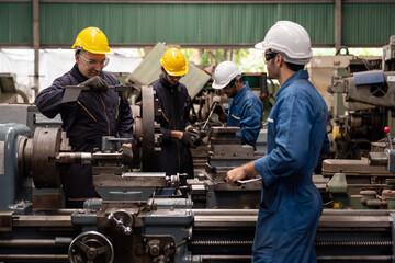 Group of male engineer worker maintenance machine in industry factory. Male technician worker working, repair machine lathe metal in the industry factory