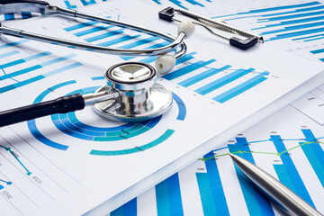Fototapeta Business audit and analysis concept. Stethoscope on the financial charts. obraz