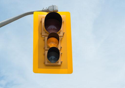yellow traffic light on sky