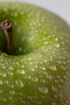 Closeup of green apple with water drops