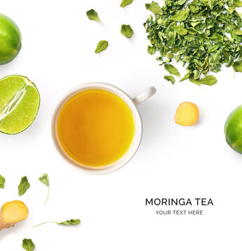 Creative layout made of cup of moringa tea, ginger and lime on white background.Flat lay. Food concept.