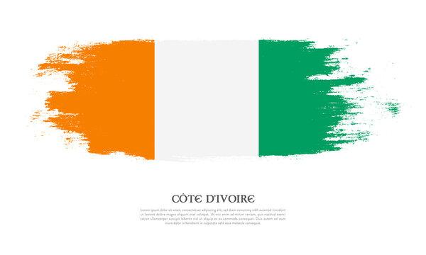 Cote dIvoire flag brush concept. Flag of Cote dIvoire grunge style banner background