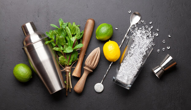 Mojito cocktail making. Ingredients and drink utensils
