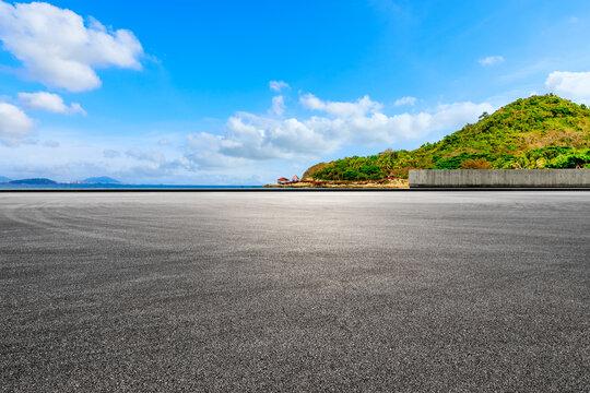 Asphalt road and beautiful seaside scenery under blue sky.