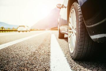 Fototapeta Car is standing on the breakdown lane, asphalt and tyre, Italy obraz