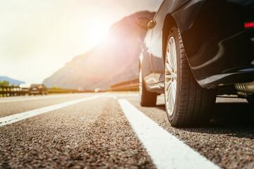 Obraz Car is standing on the breakdown lane, asphalt and tyre, Italy - fototapety do salonu