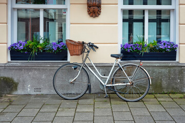Fototapeta Bicycle parked near the house in the Netherlands obraz
