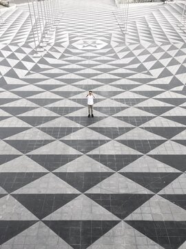 High Angle View Of Man Standing On Tiled Floor