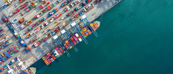 Obraz Aerial view container ship in port at container terminal port, Ship of container ship stand in terminal port on loading, unloading container, Commercial cargo ship in sea port. - fototapety do salonu