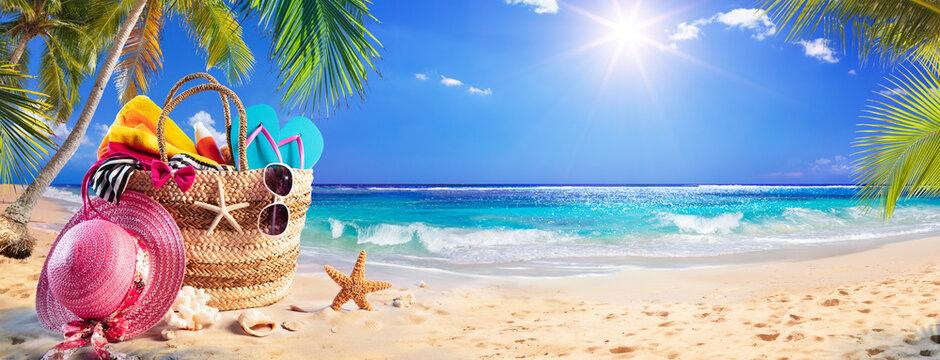Beach Bag On Tropical Sand With Palm tree and Sunny Sea