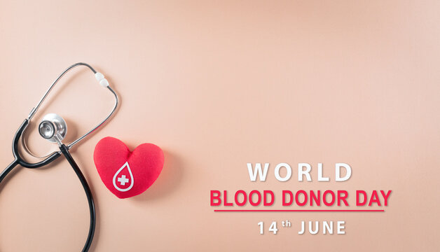 Medical and donor concepts. Doctor stethoscope and a handmade red heart with a sign or symbol of blood donation for world blood donor day with the text.
