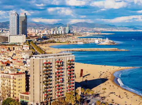 Cityscape with the coastline and Barceloneta Beach, elevated view, Barcelona, Catalonia