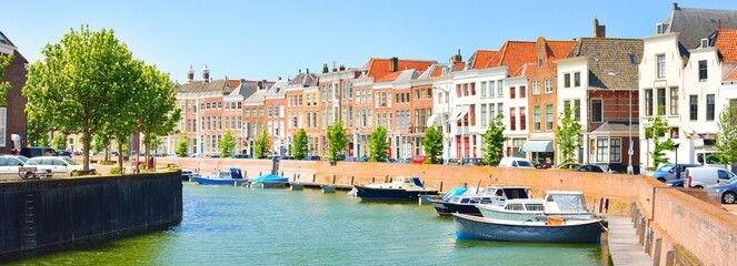 Middelburg city centre. Panoramic aerial view. The Netherlands. Yachts and boats anchored in canal. Traditional architecture. Travel destinations, landmarks, sightseeing, vacations, sailing - fototapety na wymiar