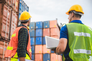 Obraz logistic worker teamwork and partner of foreman, engineer, and businessman working in an international shipping area, concept of business industrial and working in container yard to import and export - fototapety do salonu