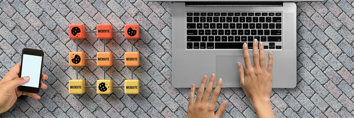 Obraz Dice with Cookie icons and the word WEBSITE and a laptop conceptual of the GDPR regulations introduced by the EU governing data collection and privacy of information for individuals online. - fototapety do salonu