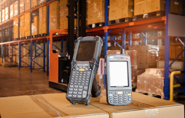 Two Bar Code Scanner on Package Boxes at Storage Warehouse. Computer Work Tools for Warehouse Inventory Management.