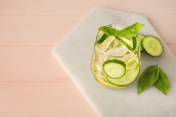 Obraz Glass with cucumber lemonade on color wooden background - fototapety do salonu
