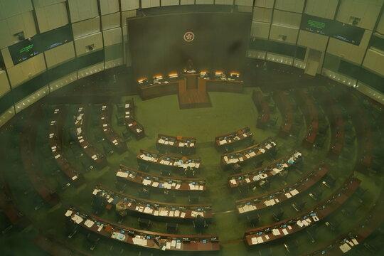 Legislators attend a meeting to debate on electoral reform bill at Legislative Council in Hong Kong