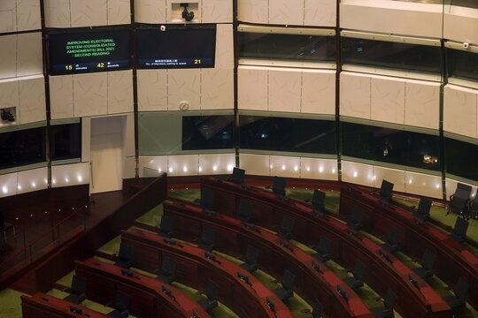 Empty seats of pro-democracy legislators are seen during a meeting to debate on electoral reform bill at Legislative Council in Hong Kong