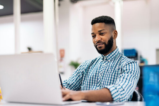 African Man Working in Office