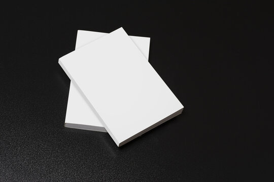 Books with blank cover isolated on a black background