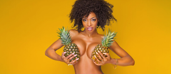 attractive girl with exotic pineapples