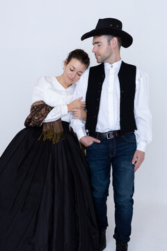A historical western romance couple standing together against a white backdrop