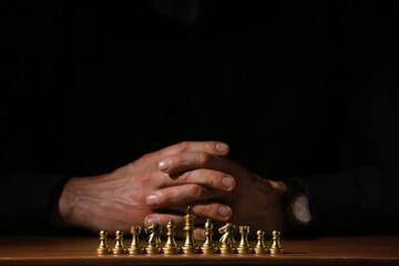 Wall Murals London Man playing chess on dark background, closeup