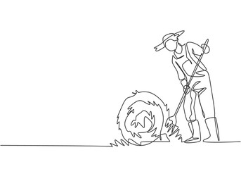 Continuous one line drawing young male farmer was stabbing a haystack and rolling it up with a straw stick. Successful farming minimalist concept. Single line draw design vector graphic illustration.
