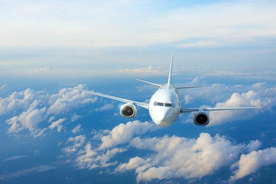 Passenger plane, business trip, travel concept. Flying evening before sunset.