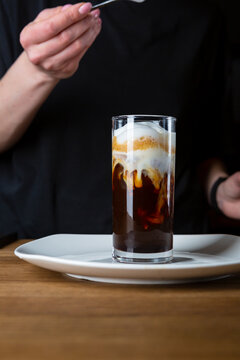 Glass with iced coffee with ice cream