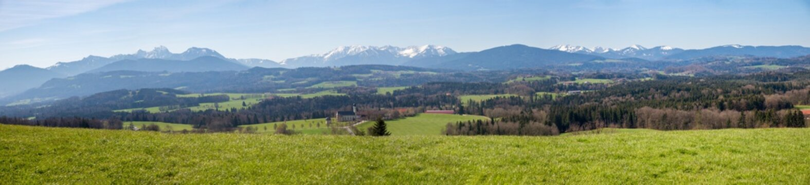 wide mountain panorama, view from Irschenberg hill to bavarian alps and rural landscape