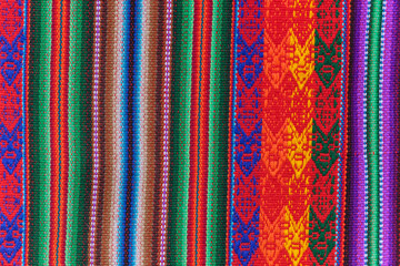 Fototapeta Peruvian crafts: Handmade fabric, with bands of colors typical of the Andean culture, which is repeated in several countries such as Ecuador, Peru and Bolivia obraz