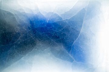 Obraz Aerial view of abstract patterns formed by snow and cracks within a blue and white frozen ice sheet - fototapety do salonu