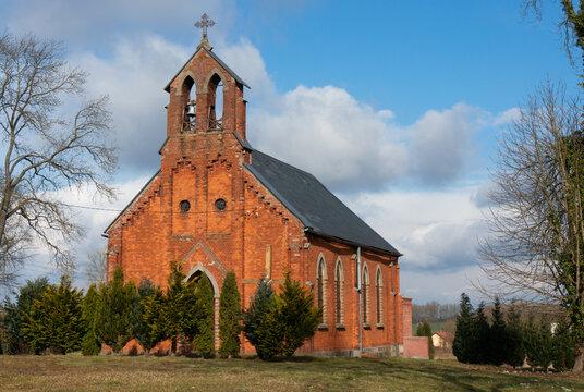 Church of Our Lady of Candlemas (Kościół Matki Boskiej Gromnicznej). Neo-Gothic brick temple was built in 1865. Village in North-Western Poland, Lobez County. Krasnik Lobeski, Poland.