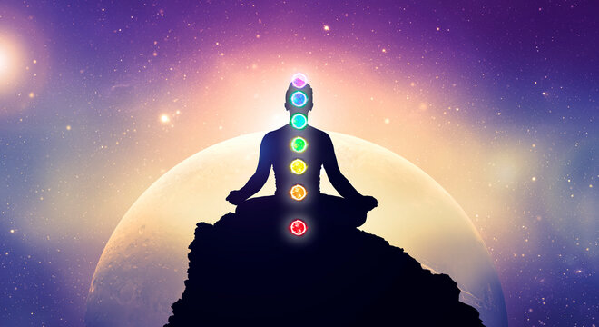 Meditating men in yoga lotus position with chakras. Mindfulness and self awereness practice. Silhiuette of meditation in space.