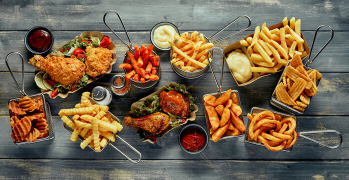 Fried potatoes and roasted chicken served with sauces