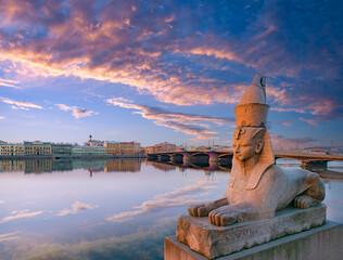 Panorama of Saint Petersburg. Sights of Russia. Sphinx on embankment of Saint Petersburg. Egyptian Sphinx in Russian city. Panorama of St. Petersburg. Annunciation bridge. Tourism in Russia - fototapety na wymiar