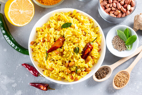 Yellow Rice, Turmeric Rice wih Lemon, Ginger and Fenugreek in a bowl, Indian Food. Top view