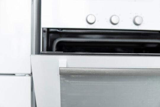 Open white kitchen oven on a comfortable kitchen.