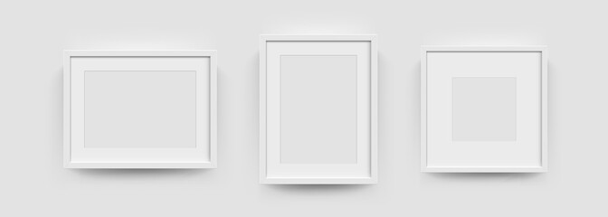Obraz Photo picture frames on wall, vector white mockups or empty posters. Empty photo frames mockups for pictures or photograph, realistic 3D blank templates - fototapety do salonu