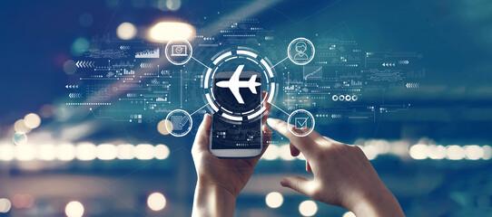 Fototapeta Flight ticket booking concept with person using smartphone obraz